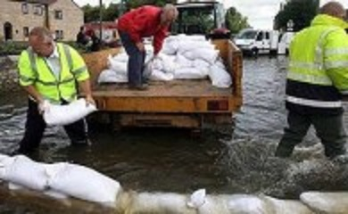 Plymouth Brethren unload sandbags during Taunton Floods