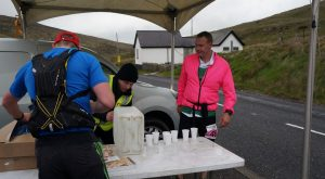 A participant getting refreshment at a station on the marathon