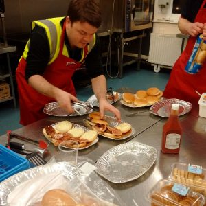 RRT cooking up sausage and bacon rolls for the evacuated people