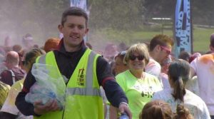 Handing out water to the runners