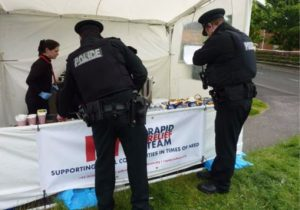 Police take a break at the RRT tent