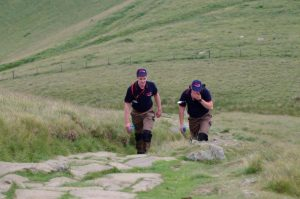 RRT marshalls climbing to Lose Hill Checkpoint