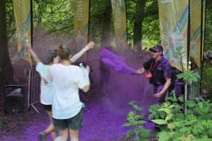RRT volunteers throwing purple dye at the 4Kilometer dye station.