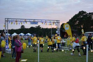 Weary walkers cross the finish line.
