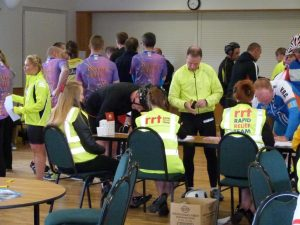 RRT volunteers provide assistance in the registration process to speed things up for the cyclists at the beginning of the event.