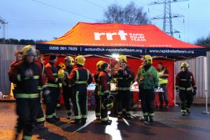 Fire crews and other emergency personnel around the RRT tent